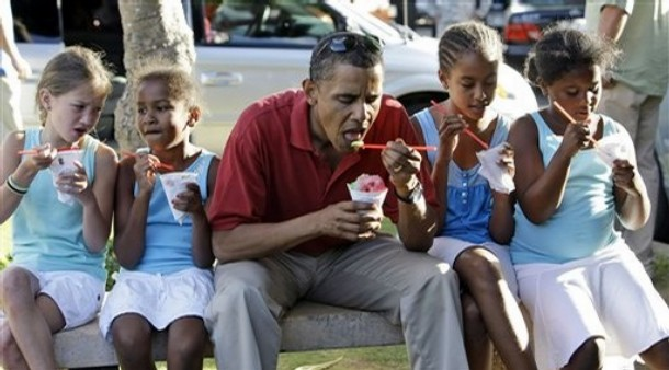 Democratic presidential candidate Sen. Barack Obama, D-Ill., eats shaved ice with his daughters Sasha Obama, 7, second from left, and Malia Obama 10, second from right, and unidentified friends in Kailua, Hawaii on Wednesday, Aug. 13, 2008. Sen. Obama is in Hawaii for a vacation. (AP Photo/Alex Brandon)