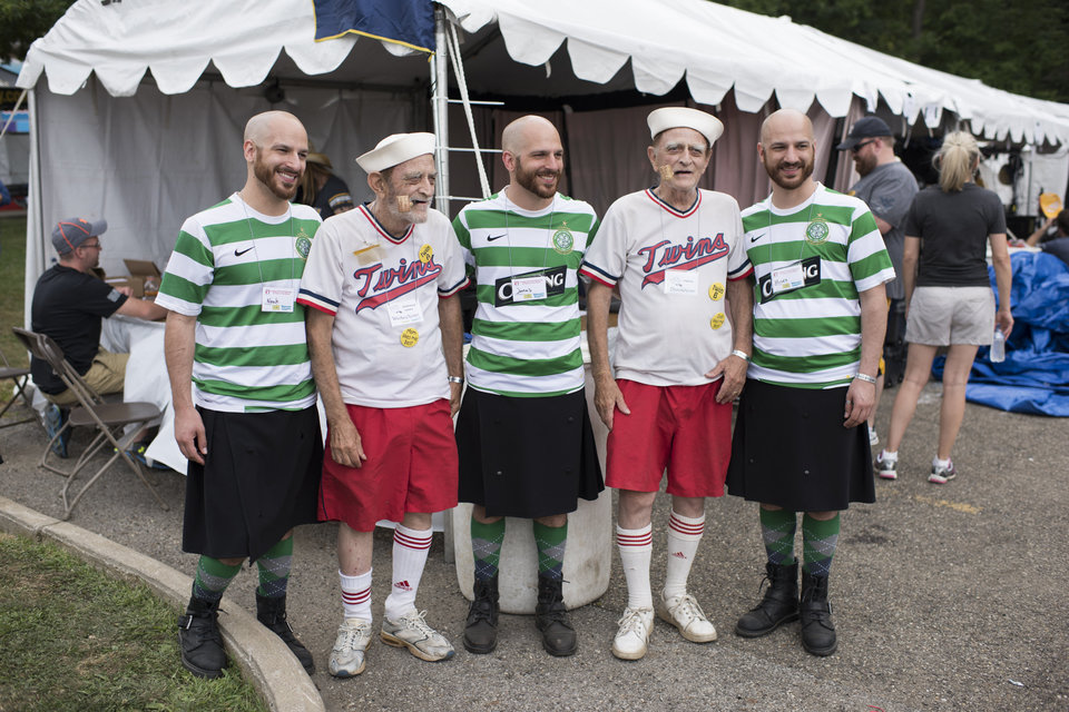 A group of identical twins pose for a portrait with identical triplets at the 40th annual Twins Days Festival in Twinsburg, Ohio on Saturday, August 8, 2015. Photo by Dustin Franz