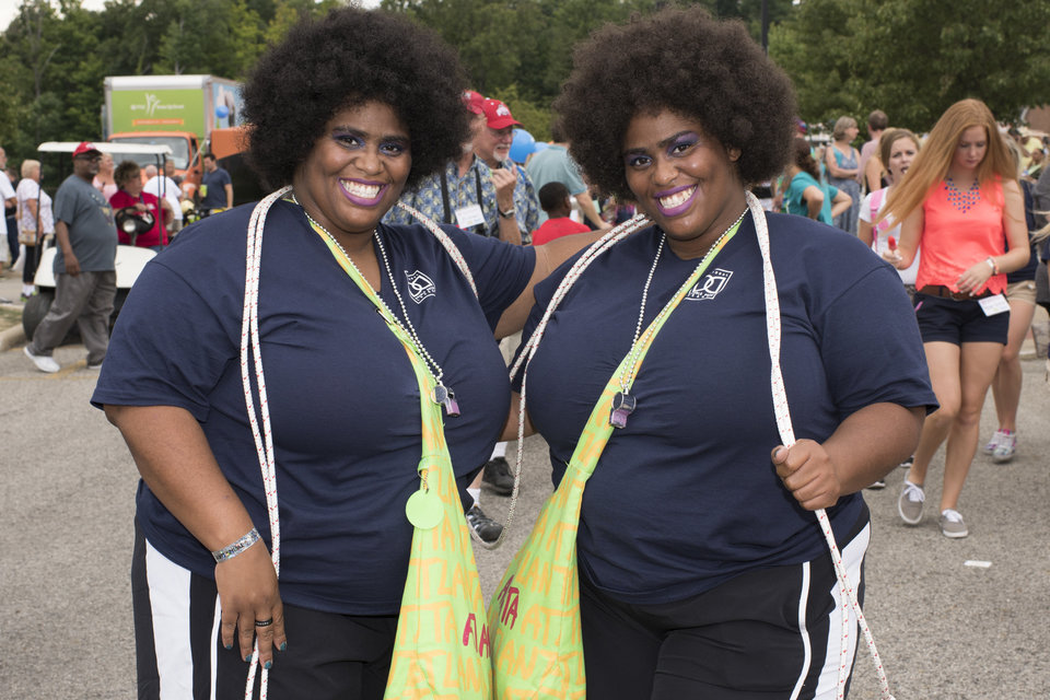 Perrena and Geneva Bernoudy, 36-year-old identical twins from Atlanta, Georgia, pose for a portrait at the 40th annual Twins Days Festival in Twinsburg, Ohio on August 8, 2015. Photo by Dustin Franz