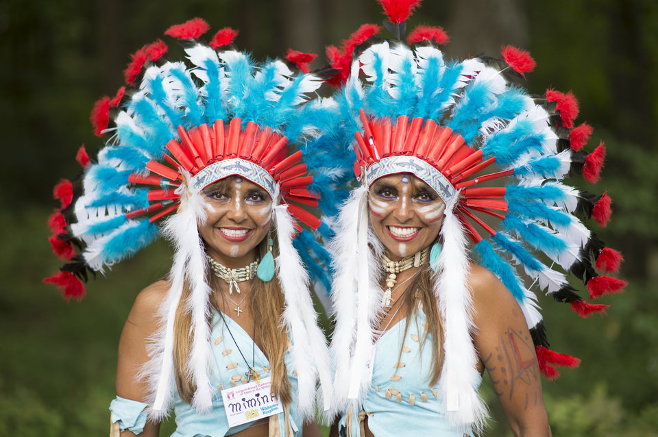 Mimina and Marita Meza Vergara, 35 from Venezuela, pose for a portrait at the 40th annual Twins Days Festival in Twinsberg, Ohio on August 8, 2015. Twins seems to run in their family with two sets of twins on both sides of their family. Photo by Dustin Franz