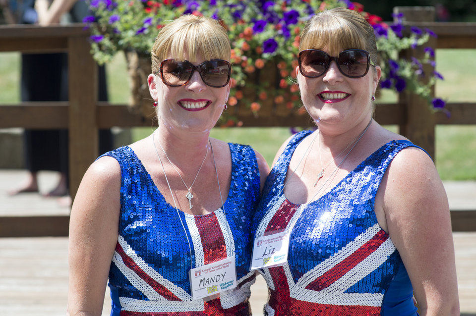"Mandy Vazquez, left, and Liz Blower came all the way from London to make the Twins Days Festival in Twinsberg, Ohio. The last time the pair attended the festival they won the ""Most Alike"" competition. Photo by Dustin Franz"
