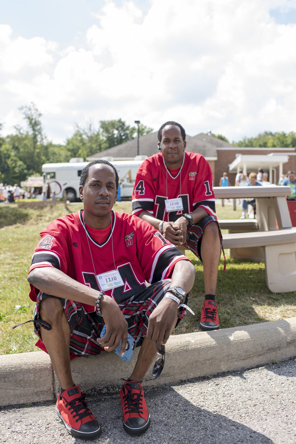 James and Charles Johnson, 33 are actually triplets but their sister, Denise, could not make it to the Twins Days Festival this year. Photo by Dustin Franz