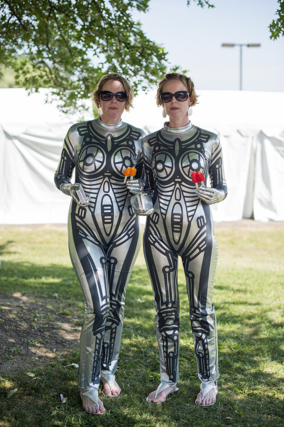 Heather and Tara Kelly, 42, pose dressed as robots during the Twins Days Festival in Twinsberg, Ohio on Saturday, August 8, 2015. Heather is from Berkely, California while her sister lives in Washington D.C. It is their first time at the festival. Photo by Dustin Franz