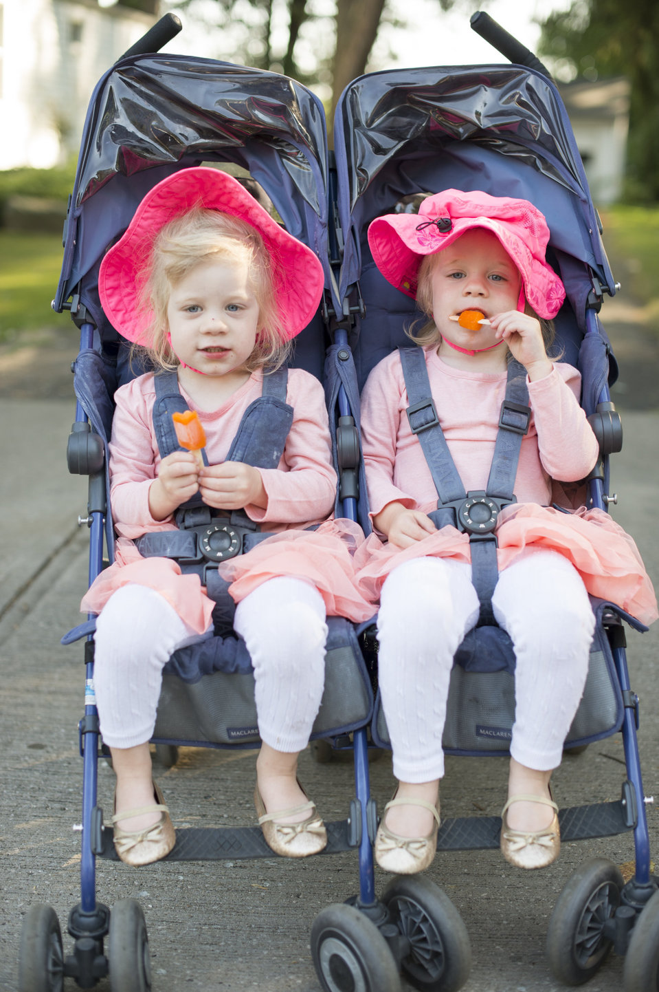Gabriella and Romola Hicks, 2 of Chagrin Falls, Ohio, watch as the Double Take Parade passes by dusring the Twins Days Parade in Twinsberg, Ohio on Saturday. Photo by Dustin Franz