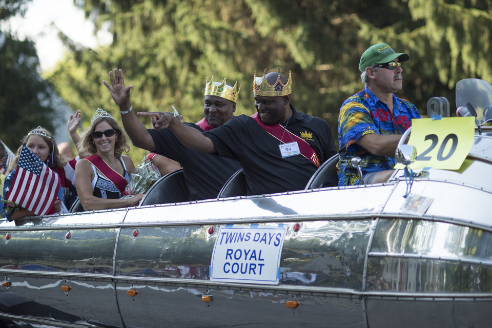 Festival Kins Richard and Robert Murphy ride the parade route Saturday during the Twins Days Festival in Twinsberg, Ohio. Photo by Dustin Franz