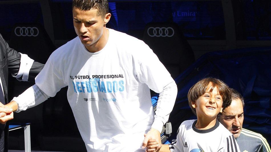 Cristiano Ronaldo e menino refugiado 1