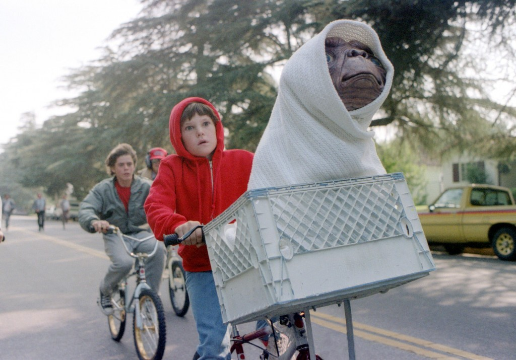 "This undated studio handout shows Elliott, played by Henry Thomas, his brother and friends riding as fast as they can from the police to get ""E.T. The Extra-Terrestrial"" back to the forest. Steven Spielberg's 1982 ""E.T. The Extra-Terrestrial"" returns to theaters Friday, updated with a couple of previously unreleased scenes, visual enhancements, improved sound and excisions that have annoyed some purists who dislike tampering with beloved films. (AP Photo/Bruce McBroom, Universal Studios Amblin Entertainment)"