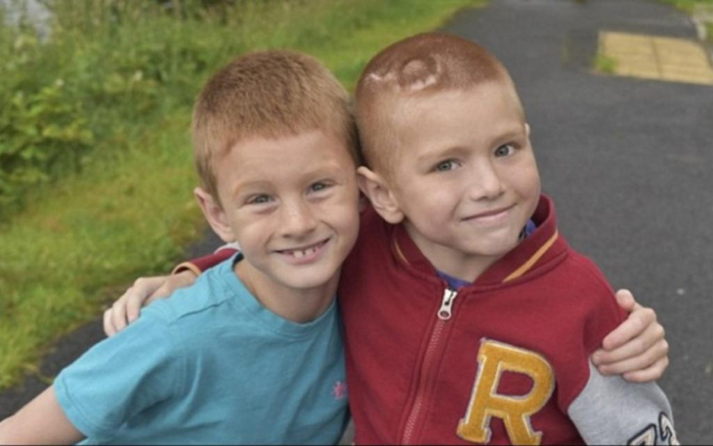 George McIntosh com o irmão Archie