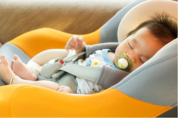 baby-child-fastened-with-security-belt-in-safety-car-seat-picture-id485494700
