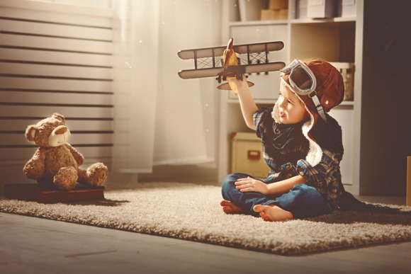 concept-of-dreams-and-travels-pilot-aviator-child-with-toy-picture-id518761786