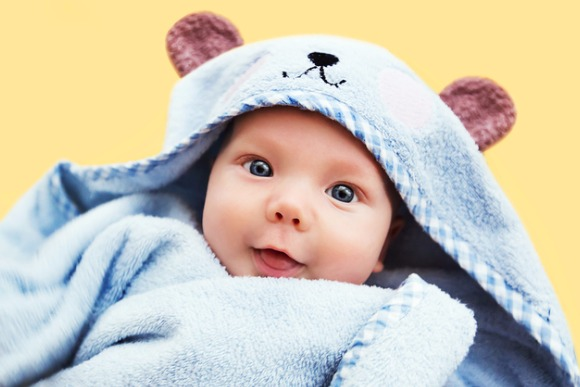 cutest-baby-child-after-bath-with-towel-on-head-picture-id641065772