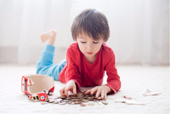 little-boy-breaking-his-piggy-bank-to-buy-gift-picture-id509472358