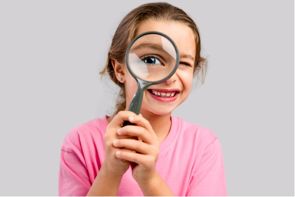 looking-through-a-magnifying-glass-picture-id611594636