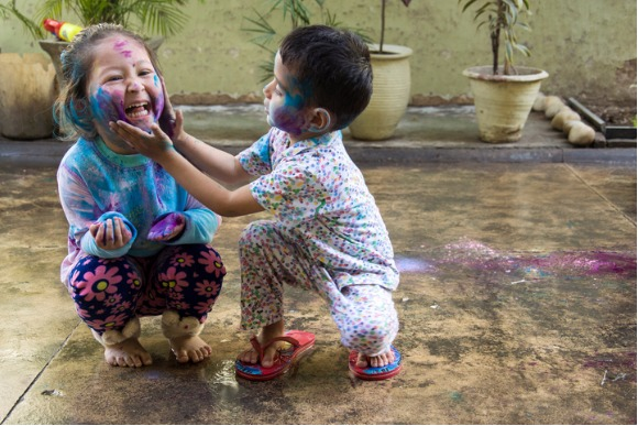 kids-celebrating-holi-festival-of-colors-picture-id636972178