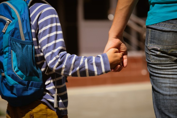 going-to-school-mother-holding-hand-of-son-picture-id673357308