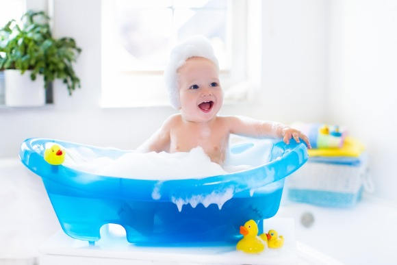 little-baby-taking-a-bath-picture-id530810600