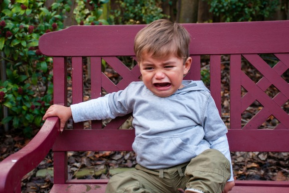 crying-toddler-on-bench-picture-id904487778