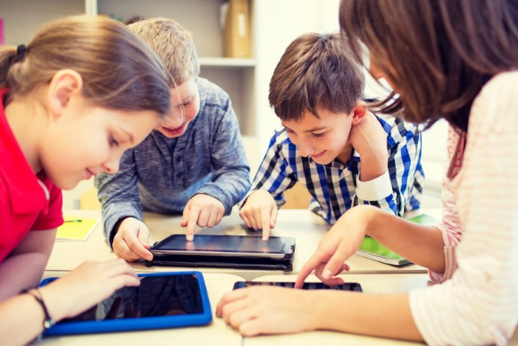 group-of-school-kids-with-tablet-pc-in-classroom-picture-id490361666
