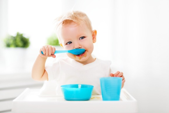 happy-baby-eating-himself-picture-id669694964