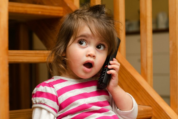 little-girl-speaks-on-the-phone-picture-id687316334