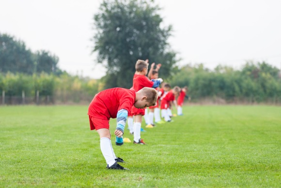 young-soccer-players-warming-up-picture-id615917380