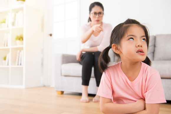 asian-mother-sitting-on-the-sofa-angry-pointing-picture-id835621860
