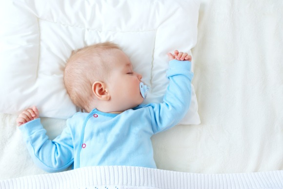 baby-sleeping-on-blue-blanket-picture-id660340904