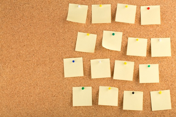 cork-board-with-sticky-notes-picture-id477807332