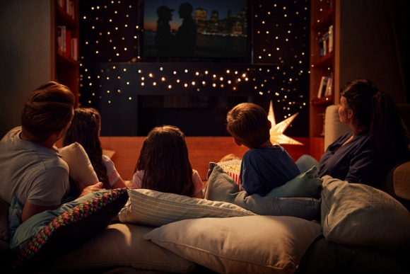 family-enjoying-movie-night-at-home-together-picture-id872006222