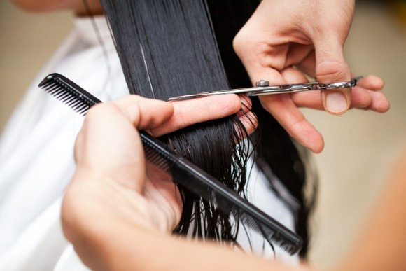 hairdresser-cutting-hair-picture-id166669537