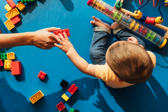 happy-baby-playing-with-toy-blocks-picture-id817588604