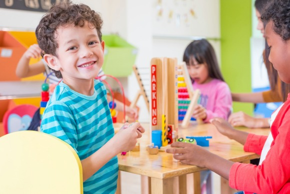 kindergarten-students-smile-when-playing-toy-in-playroom-at-preschool-picture-id836871426