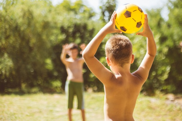 two-boys-playing-with-ball-picture-id594940570