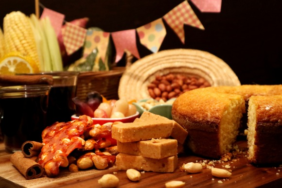 brazilian-food-for-june-feast-festa-junina-treats-on-decorated-table-picture-id971508166