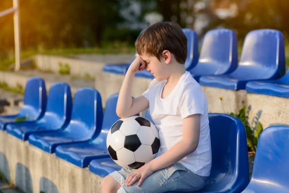 small-football-fan-disappointed-picture-id533327716