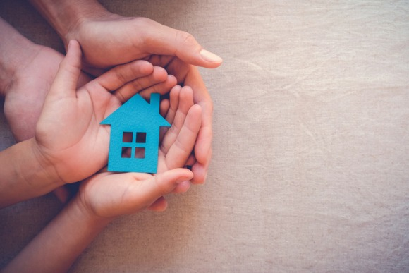 adult-and-child-hands-holding-paper-house-family-home-and-real-estate-picture-id823095136
