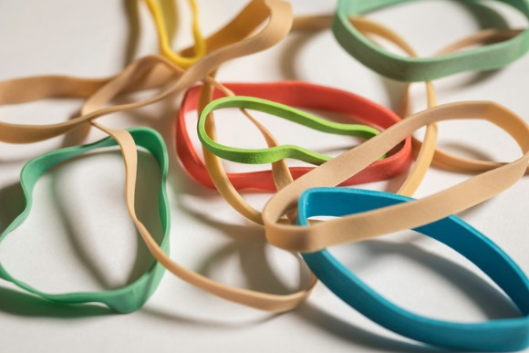 normal-and-colored-rubber-bands-picture-id884362336