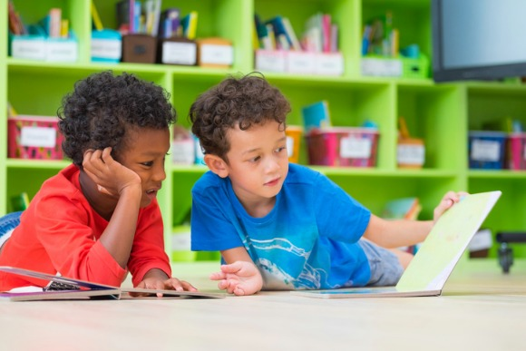 two-boy-kid-lay-down-on-floor-and-reading-tale-book-in-preschool-picture-id832178230