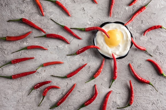 hot-chilli-pepper-concept-winner-sperm-egg-idea-ovulation-pregnancy-picture-id909738916