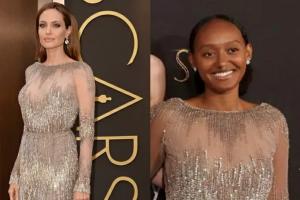 Filha de Angelina Jolie utilizando o mesmo vestido que a mãe usou no Oscar de 2014